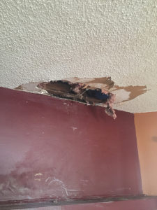 Denied roof damage claim by insurance company